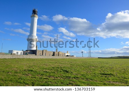 white lighthouse with blue sky in Aberdeen,Scotland, UK - stock photo