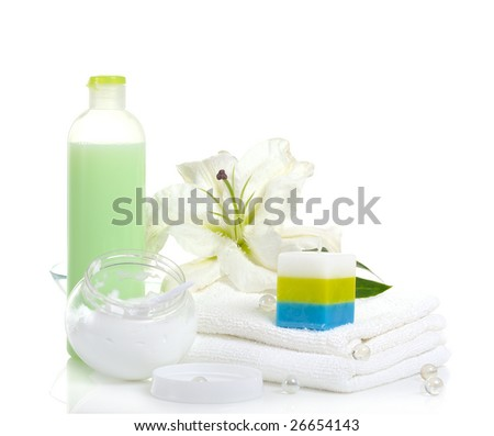 white lily, towels,candle, body cream on white background