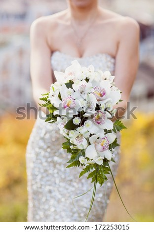 white lily wedding bouquet in the hands of the bride - stock photo