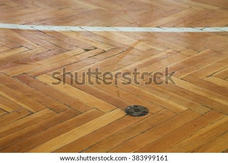 White line in hall playground. Worn out wooden floor of sports hall with colorful marking lines