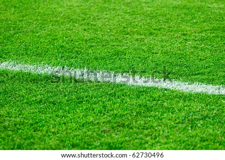 White line on a football field grass - stock photo