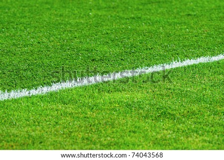 White line on a soccer field grass - stock photo