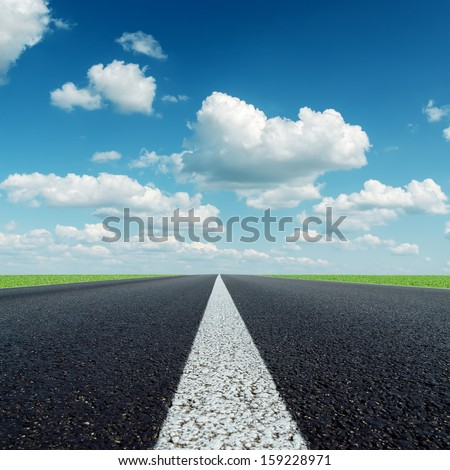 white line on asphalt road and cloudy sky - stock photo