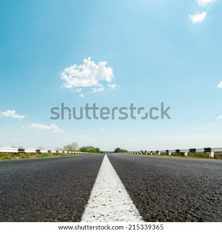 white line on asphalt road and sunny sky with clouds - stock photo