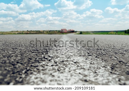 white line on asphalt road close up. soft focus - stock photo