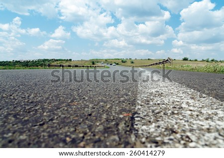 white line on asphalt road closeup. soft focus - stock photo