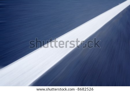 white line on the road with motion blur - stock photo
