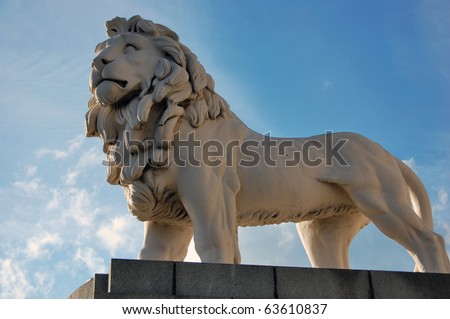 White lion statue on Westminster Bridge in London. - stock photo