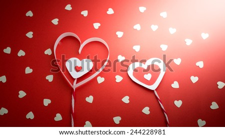 white little hearts on red background