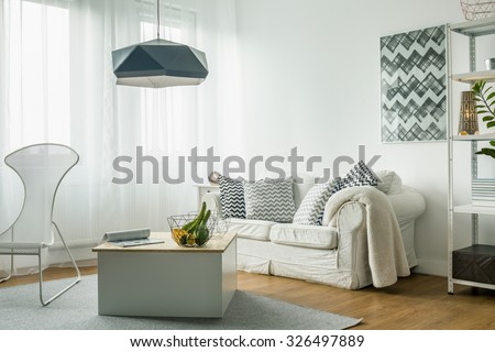 White living room idea and modern details - stock photo