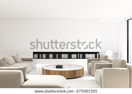 White living room interior with loft windows, a bookshelf and comfortable beige sofas standing near a round table with books on it. Front view. 3d rendering mock up