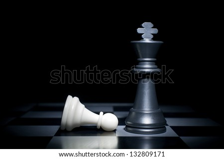 White lost. Pawn at the feet of the King - stock photo