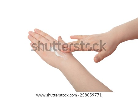 white lotion on a hand, isolated on white