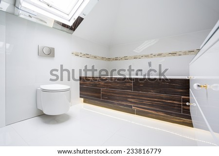 White luxury bathroom with inclined wall