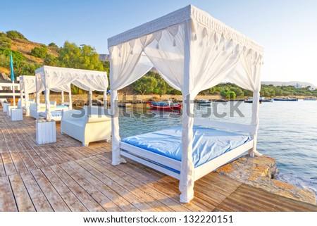 White luxury beds at Mirabello Bay on Crete, Greece - stock photo