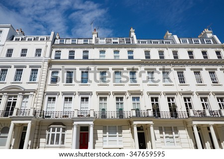 White luxury houses facades in London, english architecture with blue sky - stock photo