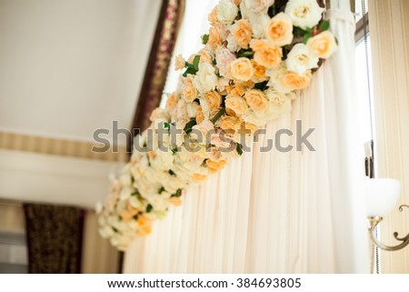 White, luxury wedding reception table arrangement with flowers centerpiece - stock photo
