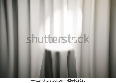 White magician's table with limelight and curtains in the background. Mock up, 3D Rendering