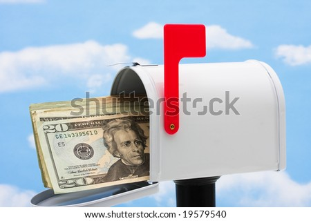 White mailbox filled with twenty dollar bills and a blue sky and cloud background, mailbox - stock photo