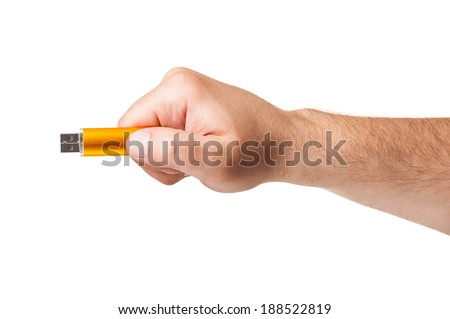 White male hand holding an usb flash drive isolated on white background - stock photo
