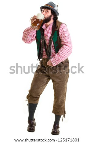 White male in Bavarian clothing, drinking a glass of beer. Oktoberfest concept. Studio shot, isolated on white. - stock photo