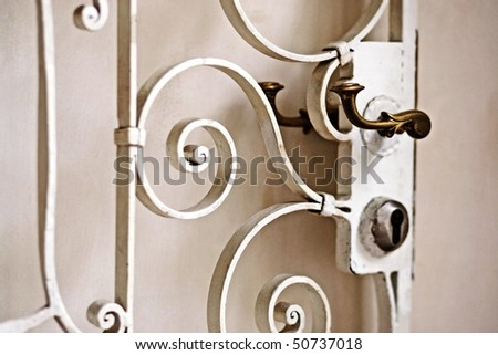 white malleable iron door with some ornamentation - stock photo