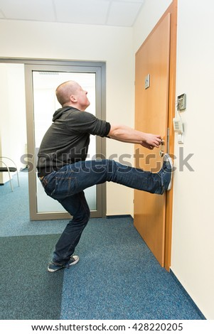 white man opens the door force - stock photo