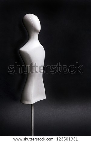 white mannequin isolated on black - stock photo