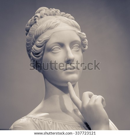 White marble head of young woman. - stock photo