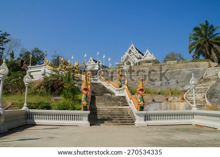 White marble staircase with sculptures of golden snakes on railings - stock photo