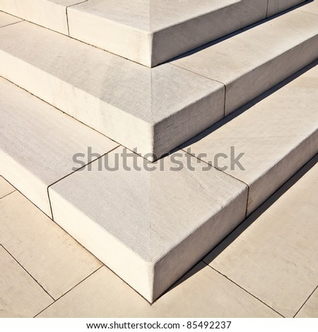 White marble stairs outdoors with shadows on right side. - stock photo