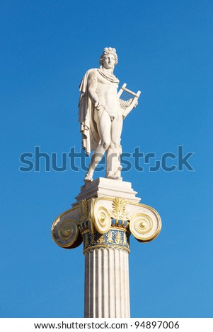 White Marble statue of Apollo in front of the Academy of Athens, Greece - stock photo