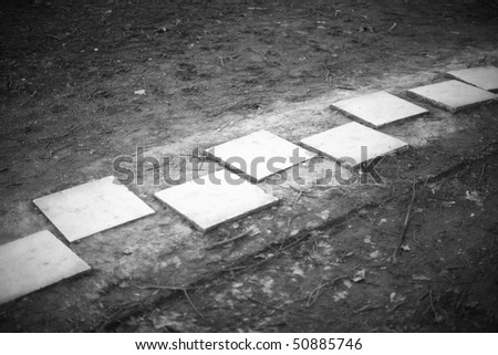 White marble stepping stones, vignette photograph - stock photo