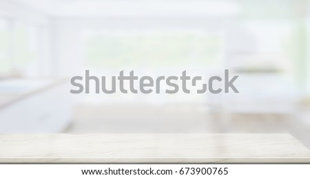 marble table top background. white marble table top on blur kitchen window background. for product or foods montage. background r