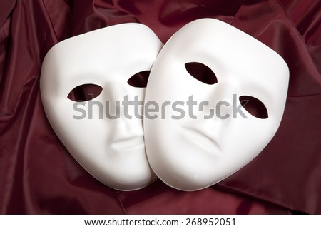 White mask and red silk fabric, isolated on white background - stock photo