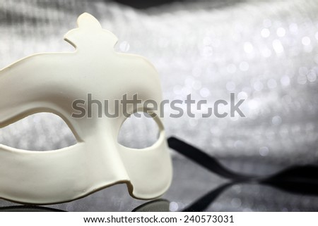 White mask in front of glittering background - stock photo