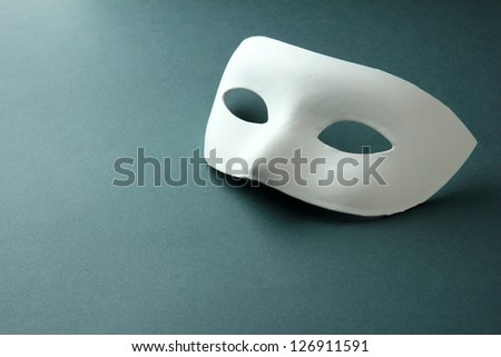 White mask, on grey background - stock photo