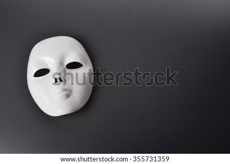 white mask on grey background - stock photo