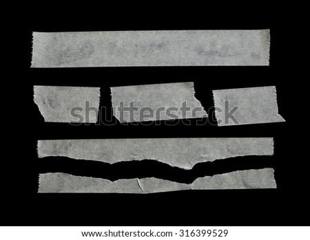 White masking tape isolated on black background. - stock photo
