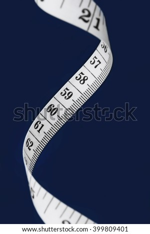 White measuring tape on a black background - stock photo