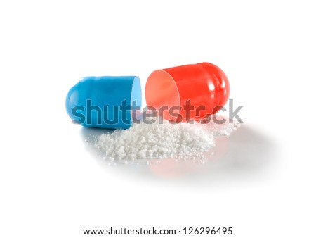 White medicament powder from open capsule isolated on the white - stock photo