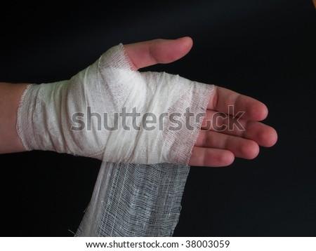 White medicine bandage on human injury hand - stock photo