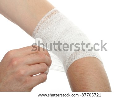white medicine bandage on injury elbow on white background