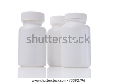 white medicine bottles with reflex isolated white - stock photo