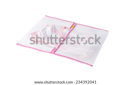 white mesh laundry bag with blouse isolated on white background
