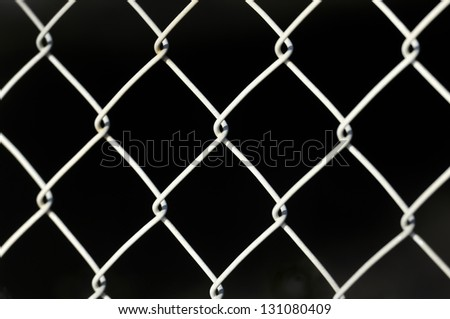white metal fence isolated with black background - stock photo
