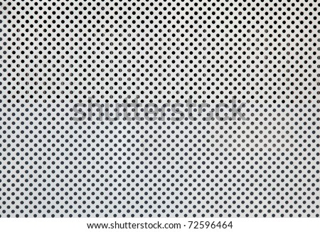 White metal plate with many small circular holes - stock photo