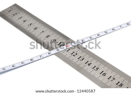 White metal ruler and measuring tape on a white background