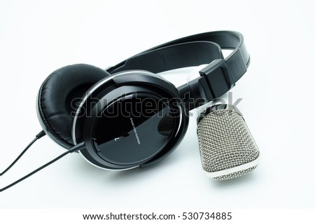 White microphone and black headphones, on white background