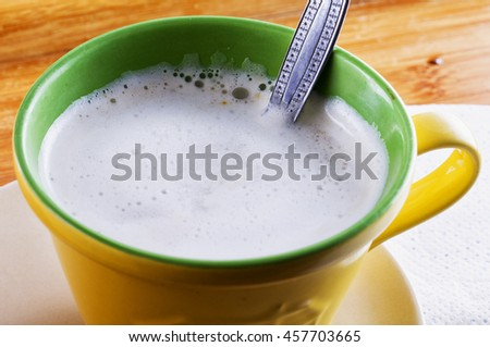 White milk in a cup, horizontal image - stock photo